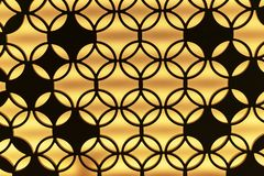 The contour of a metal lattice with an ornament on a yellow background royalty free stock photography
