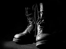 Contour of military boots. On black background front view Stock Images