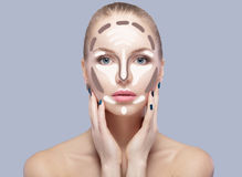 Contouring. Make up woman face on grey  background. Contour and highlight makeup. Royalty Free Stock Photography