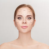 Contouring. Make up woman face on grey background.  Professional Royalty Free Stock Images