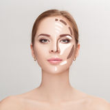 Contouring. Make up woman face on grey background.  Professional Stock Image