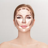 Contouring. Make up woman face on grey background.  Professional Royalty Free Stock Image