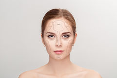 Contouring. Make up woman face on grey background.  Professional Royalty Free Stock Photography