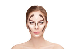 Contouring. Make up woman face on white background.  Professiona Royalty Free Stock Image