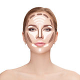 Contouring. Make up woman face on white background.  Professiona Stock Image