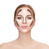 Contouring. Make up woman face on white background.  Professiona Stock Image