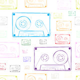 Contours of audio cassettes white. Seamless texture with multi-colored contours of audio cassettes Royalty Free Stock Photos