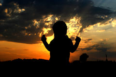 Contours of a child. Child looking the sunset stock photos