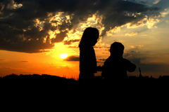 Contours of children. Children looking the sunset Stock Images