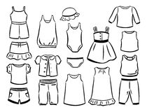 Contours of clothes for little girls. Set of contours of clothes for little girls isolated on white background Royalty Free Stock Image