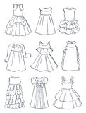 Contours of festive dresses for little girls. Beautiful ruffles, curvy skirts,wonderful styles for little princesses, isolated on white background Stock Photos