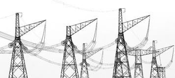 Contours of high voltage electric towers Royalty Free Stock Photo