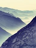 Contours of sharp mountains,  side by side increased from morning high humidity Stock Photo