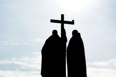 Contours of two Orthodox monks with a cross Royalty Free Stock Photos