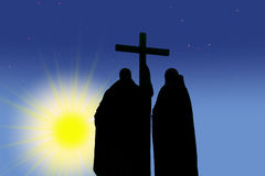 The contours of two Orthodox monks with a cross ag stock photo