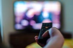 Contrôle de TV dans la main Photographie stock libre de droits