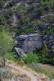 Contra todas as probabilidades Cliff Climber Climbs Fotografia de Stock