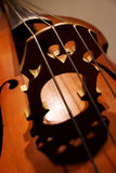 Contrabass heart#1. Fragment of a contrabass sounding board and bridge close up Royalty Free Stock Photography