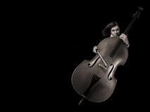 Contrabass musician. Over black background Stock Images