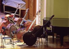 Contrabasses and piano on stage orchestra Stock Photos
