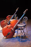 Contrabasses on a scene of a concert hall Stock Photos