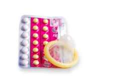 Contraceptive Methods. Condoms and contraceptive pills on white background stock photos