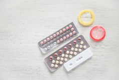 Contraceptive pill and Condom Prevent Pregnancy Contraception safe sex concept Birth Control with Condom and Pregnancy Tests stock image