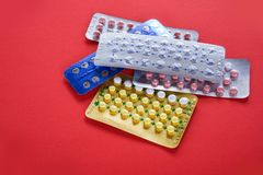 Contraceptive pill Prevent Pregnancy Contraception concept Birth Control on red background. / health care and medicine - Oral contraceptive pills royalty free stock photos