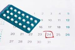 Contraceptive Pills on calendar background. Birth Control Pill calendar mark stock photo