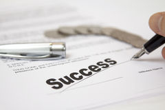 Contract. Signed succesfully with coins in the background royalty free stock images