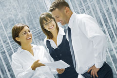 Contract. Portrait of young business people  discussing project in office environment Stock Photo