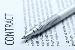 Contract. Close-up of silver pen on contract. Selective focus on top of pen. Toned monochrome image Stock Images