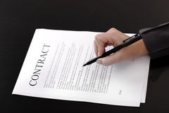 Contract. Business woman signing contract; business concepts and ideas Royalty Free Stock Image