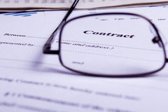 Contract. A contract viewed trough glasses Stock Photography