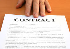 Contract. Male hand presents a contract document Stock Photo
