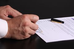 Contract. Close-up of a men hand signing a contrat stock photography