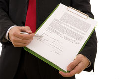 Contract. Business man showing the place where the seller must sign the contract (home made contract Stock Photo