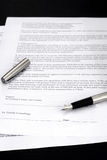 Contract. Unfinished contract with pen on table Stock Photos