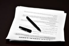 Contract Agreement with Pen on Desk Royalty Free Stock Image