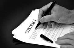 Contract Agreement with Pen on Desk Royalty Free Stock Images