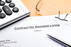 Contract for Assisted Living. With calculator, glasses and ballpoint pen or biro stock photo