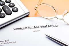 Contract Assisted Living Residence. Contract for Assisted Living Facilities with calculator, glasses and ballpoint pen or biro stock photos