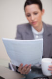 Contract being read by businesswoman Royalty Free Stock Photos
