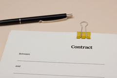 Contract with blank fields and pen Stock Image