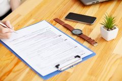 Contract. Blank of paper is on a wooden desk. Blank a4 paper is in the middle of wood office desk table with supplies. Top view with copy space, flat lay stock photography