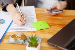 Contract. Blank of paper is on a wooden desk. Blank a4 paper is in the middle of wood office desk table with supplies. Top view with copy space, flat lay royalty free stock photos