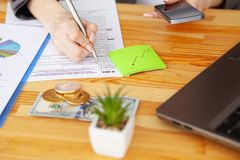 Contract. Blank of paper is on a wooden desk. Blank a4 paper is in the middle of wood office desk table with supplies. Top view with copy space, flat lay royalty free stock images