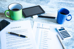 Contract and Business Plan. Analyzing a Contract and a Business Plan Royalty Free Stock Photography