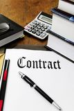 Contract and calculator on a desk. Contract, calculator, pen, books on a desk Royalty Free Stock Photography