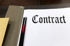 Contract and coffee on a desk stock photos
